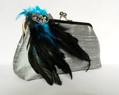 Silver silk clutch with peacock feathers.