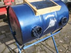 Sandblasting Cabinet Homemade sandblasting cabinet constructed from a 55-gallon steel drum, square tubing, wood, clear plastic, and wire mesh