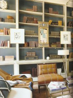 LOVE THE QUALITY & DETAIL IN THESE BOOKSHELVES.  GOOD EXAMPLE OF AMOUNT OF DETAIL I WANT IN LADIES OFFICE BOOKSHELVES/CABINETRY SYSTEM..  love how the bookcase moldings designed w/ the bead edge in gold/guilded trim ..but just put cabinets below... like how shelves divided and amount of space on each shelf...beautiful & classic!  -bookshelf styling/subtle metallic trim / love it...suzanne kasler