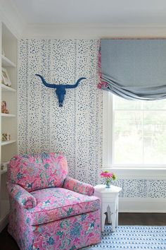 Brittany Bromley Interiors - A pink and blue accent chair sits on a blue rug beside a white Moroccan accent table and beneath a blue painted skull fixed to a wall clad in Brunschwig & Fils Les Touches Wallpaper. Pink Pillows, Pink Bedding, Formal Dining Set, Girls Bedroom Colors, Blue Accent Chairs, How To Dress A Bed, Brown Furniture, Blue Rooms, Pink Walls