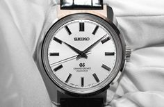 "This year at Basel, Seiko celebrates its 100 years of watchmaking. And as a sign of their confidence, they weren't exactly afraid of re-inventing the wheel. The company introduces a new limited edition re-issue of the Grand Seiko 44GS. The 44GS, as most Seiko collectors would know, is THE timepiece that sets the standard for all GS design moving forward. It was the first GS that embodied the iconic characteristics and razor sharp edge design of the ""Grand Seiko Style""."