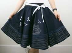 Swing skirt made in 1950s circle skirt design with full embroidery of marine seaside life.   Skirt is made from navy blue cotton fabric with sateen finish and elastic waist for easy fit. It is fully lined so can be worn during any season.