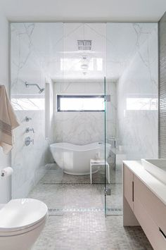 """""""wet room"""" concept This is where you consolidate the tub & shower into a single space This space is a modern style- but the layout/concept is what I am focusing in on here."""