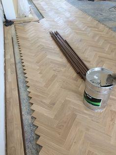 Prime grade oak parquet with a walnut tramline. Oak Parquet Flooring, Flooring For Stairs, Wooden Flooring, Hardwood Floors, Wood Floor Stain Colors, Wood Floor Design, Real Wood Floors, Harringbone Tile, Herringbone Wood Floor
