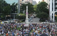 Protests: Hundreds of people staged a protest against the flag (center) in Columbia, SC, on Saturday
