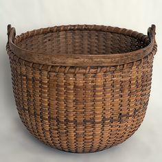 """A 7"""" open round Nantucket lightship basket with cane staves and wooden ears.   C.1890, unknown maker.   For more information please email us or call 508-228-0960."""