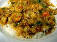 Crawfish Etouffee ...my granny Betty makes it like no other!! id beat someone for their bowl. haha