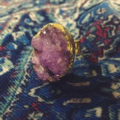 """Purple Druzy Ring Purple druzy ring with gold hardware. Adjustable band to fit all sizes! Approximately 1"""" L x 0.75"""" W ring face. Please note these are natural/genuine stones so the shape/texture/color pattern will vary slightly with each ring. Price firm unless bundled (I have a 30% bundle discount)  I have 3 purple available and I also have blue ones available in my closet. Price is for one ring. Comes with dust bag. Red & Moon Jewelry Rings"""