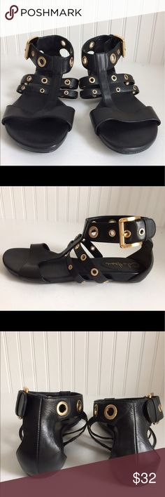 Cole Haan  black gladiator buckle sandals size 8 Black Cole Haan gladiator sandals with gold hardware.  These Cole Haan sandals have Nike air technology. They will be cute and comfortable.  Some mild scuffing These are preowned and have been worn but are in very good condition. Size: 8M Cole Haan Shoes Sandals
