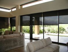 Smart Weave 3% Screen Roller Shades. You can see out, but nobody can see in and you still get the view! :)