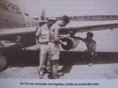 Portuguese Air Force T-6 plane being armed with rockets - African Colonial War 1961-1974