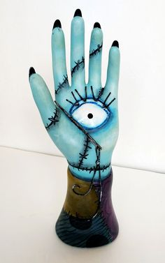 Sally Hand - acrylic and paperclay on ceramic hand ring holder