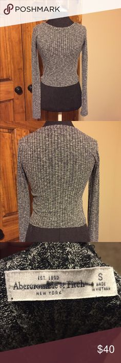 Abercrombie and Fitch Gray Crop Sweater This stretchy sweater has long sleeves and is slightly cropped. It is gray and ribbed Abercrombie & Fitch Sweaters Crew & Scoop Necks