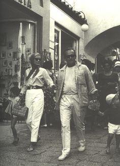 Grace Kelly and Prince Rainier of Monaco. Capri, Italy. Circa early 1960's. That's very likely Caroline (b.1957) holding Grace's hand and Albert (b.1958) with Ranier.