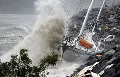 Waves stirred up by Cyclone Ului batter former Sydney to Hobart race yacht Anaconda II against the seawall at Airlie Beach along the Queensland state coast - Picture: AFP/GETTY