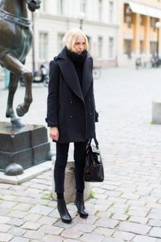 Winter Chic: 40 Stellar Street Style Outfits to Copy Right Now   StyleCasterAn easy trick to copy: Add black socks to cropped trousers and ankle booties. Then add a chunky turtleneck sweater and an oversized peacoat.