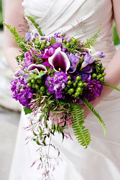 Wild purple bouquet with hydrangeas, dahlias, Picasso calla lilies, stock, freesia, hypericum berries, sword fern, and jasmine.