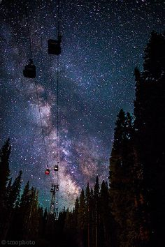 (Aspen colorado gondola with milky way) (Aspen Colorado gondola with the Milky Way) This would seem magical to be in one of those gondolas looking at the stars and feeling the breeze as the cable moves.