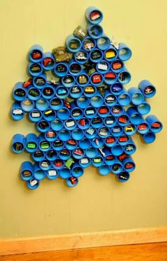 This is awesome! Hot Wheels car storage - would be cool to make into a design for Rykers room!
