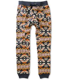 Get the rad jogger style with a gusseted drop crotch and a fresh all-over multicolor tribal print with contrasting navy elastic ribbed ankle cuffs.
