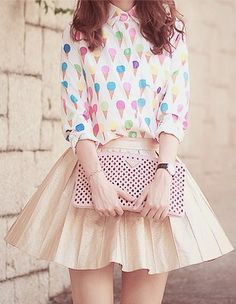 I am in love with this ice cream printed blouse with the nude colored skirt.