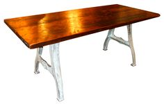 Wood plank table on brushed metal industrial base