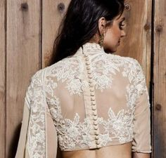 Looking for latest blouse designs for net sarees? Here are 46 ultimate net blouse collections that you can rock with any saree! Netted Blouse Designs, Saree Blouse Neck Designs, Choli Designs, Saree Blouse Patterns, Fancy Blouse Designs, Back Design Of Blouse, Sari Design, Beau Sari, Net Saree Blouse