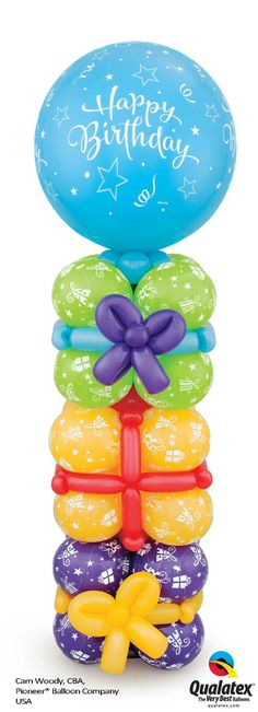 A tower of gifts for the birthday boy or girl! This balloon column is topped with a 3 ft balloon. #qualatex #balloon  #birthday