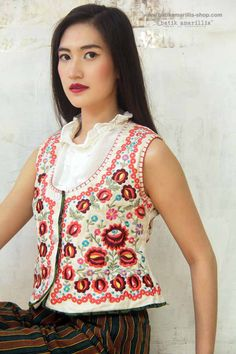 Batik Amarillis made in Indonesia proudly presents: Batik Amarillis' s Folklore vest 2015 :vintage waistcoat inspired features Hungarian's meticulous,colorful & intricating embroidery style on raw & beautiful Tenun gedog Tuban of Indonesia with batik gedog piping