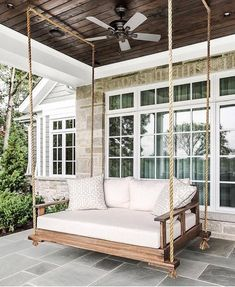 Glorious farmhouse porch bed swing with a fabulous dark wood slat ceiling. Farmhouse Porch Swings, Farmhouse Front, White Farmhouse, Farmhouse Homes, Farmhouse Decor, Backyard Swings, Backyard Ideas, Porch Bed Swings, Swinging Porch Bed