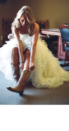 I will most definitely be wearing cowboy boots with my wedding dress! You cannot take the country out of this girl.. as much as I like to hide it! sooooo doing this! Amen!:)