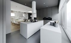 This modern kitchen houses two all-white islands.