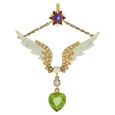 c.1910, suffragette pendant. Worn to show support for women's right to vote. The pendant features the official colors of the suffragette movement: violet to represent dignity, white for purity, and green for hope