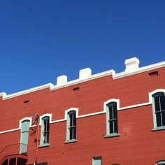 Late September: Brick Building and Sky | R. S. Williams