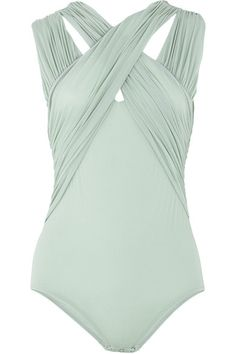 Pale-blue sleeveless jersey bodysuit with cross-over straps. Zimmermann bodysuit has a scoop neck, two gathered straps at the shoulders, two gathered straps that cross at the neck and back of the neck and push-stud fastenings underneath. 100% nylon. Dry clean.
