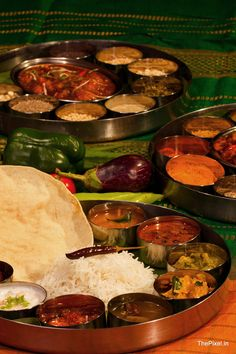 Thali - large plate with various Indian food. With 22,464 vegetarian delicacies from the states of Gujarat and Rajasthan alone, the possibilities of Indian food are endless. This is typical food eaten for lunch or dinner in India. It could consist of 4 types of shaak/subji made with potatoes, okra, beans, chickpeas etc, raita - indian yogurt, pickles, lentils, vegetables, paratha (flaked indian bread), Dahl (spicy indian lentil soup), a Indian sweet (mithai) and is one of the most healthiest…