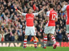 Tomas Rosicky celebrates his goal - number 2 against Everton - at the Emirates with fellow goalscorer Olivier Giroud.