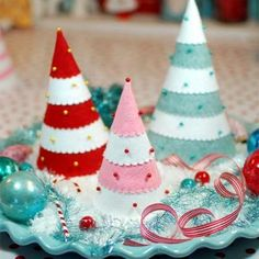 I made these, with a variety of beads as ornaments.  And little felt cutouts as decorations.  Fun and easy!