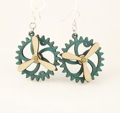 """Made in U.S.A Style # 5006G Size 1.65"""" x 1.5"""" Kinetic Gear Earring 5006G All Gears Move! Comes as shown - Teal/Natural Wood Made from Renewable and Recyclable Materials Laser-cut wood Stained with water based dye Ear wires are silver-finished 3041 stainless steel with new electrophoretic-coating that resists tarnishing"""