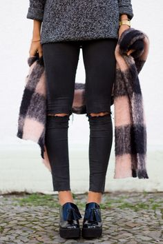 ripped black jeans + plaid scafr. Love this street style