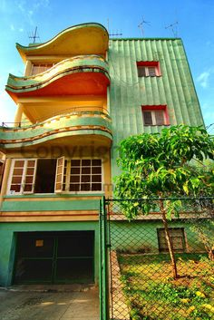 Orange? - Art Deco, Casa, Havana, Cuba I love the balconies they remind me of pianos.