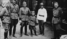 """""""It looks like a typical wartime photo. In fact it is evidence of one of the most remarkable stories of the Second World War that has only just emerged. The smiling soldiers are members of a Latvian-based SS death squad that hunted down Jews for Nazi Germany. The boy is their mascot who was lauded in propaganda newsreels as """"the Reich's youngest Nazi"""". But the filmmakers didn't know the little boy was, in fact, Jewish. He had seen most of his family massacred by men — possibly from the…"""