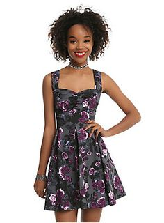 "<div>The grey swing dress has an allover black and purple floral print perfect for gothic babes. The fitted bodice has a flattering gathered sweetheart neckline with wide tank straps and a fitted waistline can be emphasized even more by the back lace-up corset detail. The full circle skirt will have you spinning with happiness! Side zipper closure. </div><div><ul><li style=""list-style-position: inside !important; list-style-type: disc !important;"">Body: 97% cotton; 3% spandex</li><li st..."