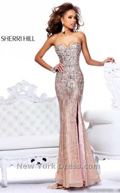 Sherri Hill 8513  Lavish Embellished Sweetheart Gown by Sherri Hill  Festive and fantastic, this exceptional evening dress from Sherri Hill 8513 is perfect for any party. The strapless sweetheart bodice shines with a dazzling array of shimmering sequins and large, glamorous rhinestone embellishments. Body conscious and fitted, this look will hug your curves to the sultry, sweep train. Available Colors: Nude, Pink, Seafoam, Strawberry, and Yellow