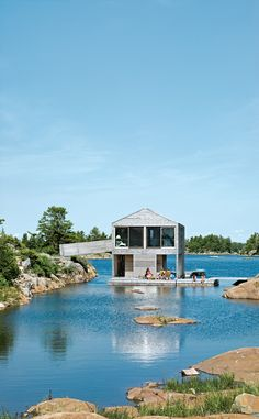 Cedar slats mark the facade of this floating lake house, belonging to the Worple's of Ontario.