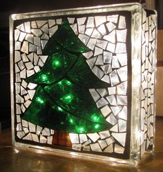 This mosaic tree design was created on a glass block used in home construction, not a craft block. All glass was hand cut and attached to the glass block using the direct glass on glass method, then grouted in a creamy white.