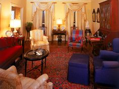 Beautifully done around the huge oriental rug. One outstanding feature is the bright plaid chair covering. Warm
