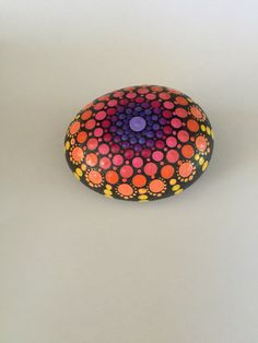 A personal favorite from my Etsy shop https://www.etsy.com/listing/465521748/mandala-stone-hand-painted-rock-dot