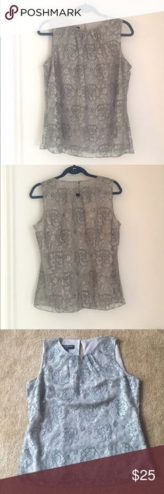 """NWT Jones New York Blouse Silver floral lace by Jones New York with a solid silver lining underneath, 91% nylon and 9% metallic fiber, with a keyhole in back. New with tags, never worn. Size 8, 40"""" bust, 36"""" waist, measurements taken flat. Offers welcome! ❤️ Jones New York Tops Blouses"""