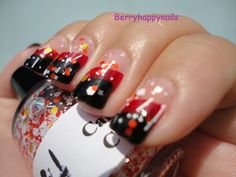 Polishes used in this tape manicure:  OPI Vodka and Caviar, and  OPI Black Onyx.  Topped with 1 coat of Girly Bits Candy Corn,  and sealed with a coat of Seche Vite TC.